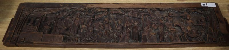 A Chinese carved hardwood figural panel length 122cm