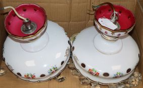 A pair of Victorian cranberry glass overlaid lustre lights