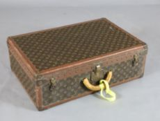 A Louis Vuitton suitcase, with brass mounted leather banded LV fabric and internal tray, no.