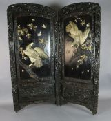 A Japanese Shibayama bi-fold screen, Meiji period, applied in ivory, bone and wood with the