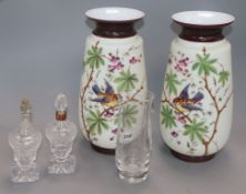 A pair of opaque glass vases, cut glass scent bottles and an etched glass