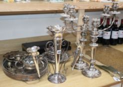 A silver plated epergne pair of candelabra, carving sets etc