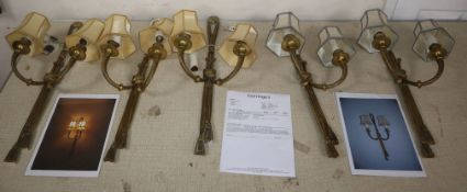 A set of five French Louis XVI brass 'rope and tassel' design two-branch wall lights