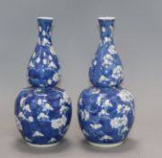 A pair of 19th century Chinese blue and white double gourd vases, Kangxi mark height 25cm
