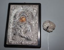 A silver icon and stone nut shaped box