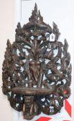 A Burmese or Indian teak wall bracket length 80cm