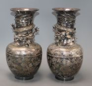 A pair of Japanese silver-plated bronze vases engraved and applied with dragons (one rim a.f.)