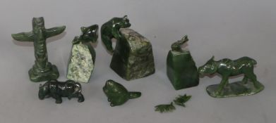 Seven Canadian green jade carvings of animals and a totum