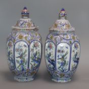 A pair of Delft polychrome lidded vases height 34cm
