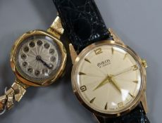 An 18ct gold ladys' wristwatch with silvered cushion-shaped Arabic dial and plated bracelet and an