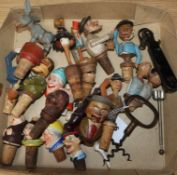 A collection of mixed ceramic and wooden bottle stoppers, two corkscrews etc
