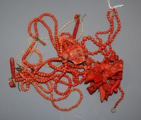 A carved coral floral spray brooch, 78mm, a triple strand coral necklace with carved floral pendant,