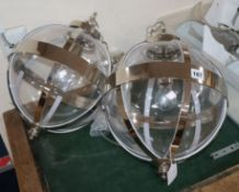 A pair of Laura Ashley contemporary glass and chrome spherical ceiling lights
