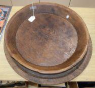Two large hardwood circular trays largest diameter 60cm