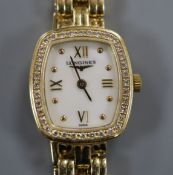 An 18ct gold ladys' Longines wristwatch with cushion-shaped grain-set diamond bezel and integral