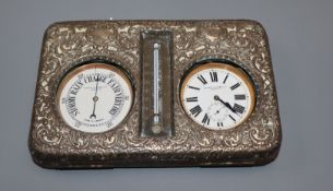 An Edwardian repousse silver mounted combination pocket watch, barometer and thermometer desk