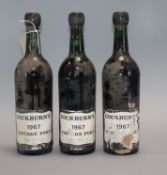 Three bottles of Cockburns 1967 vintage port