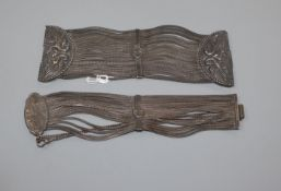 Two heavy 925 white metal multi strand bracelets.