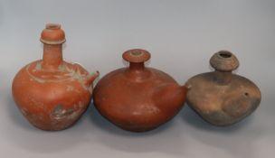 Three 19th century Indonesian pottery kendi