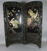 A Japanese Shibayama bi-fold screen, Meiji period, applied in ivory, bone and wood with the