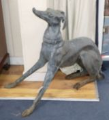 A bronze garden ornament of a seated greyhound