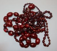 A small group of assorted simulated cherry amber necklaces including facetted.