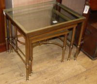 A nest of three French brass and glass tables W.56cm