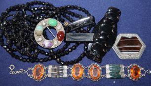 A jet bracelet, Scottish hardstone bracelet, two other hardstone brooches and other items.