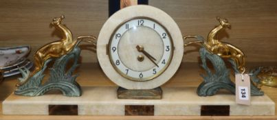 An Art Deco style onyx, marble and spelter mantel clock length 64cm