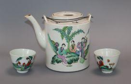 An early 20th century tea set in wicker basket