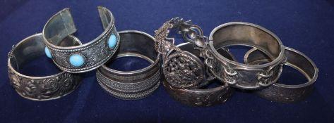 Seven assorted white metal bangles.