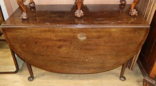 A George III mahogany drop leaf dining table, on pad feet W.122cm