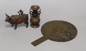A Chinese mirror, two-handled bronze vase and metal figural buffalo