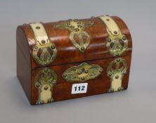 A dome topped horn and brass bound walnut tea caddy length 20cm