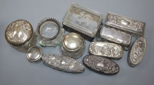 Eleven assorted Edwardian and later silver mounted glass toilet jars including Art Nouveau.