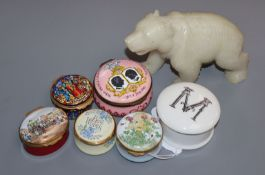 A collection of enamel pill boxes and a soapstone carved bear
