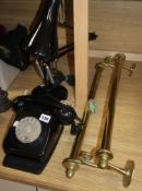 An angle poise lamp, a bakelite telephone and a brass towel rail (3)
