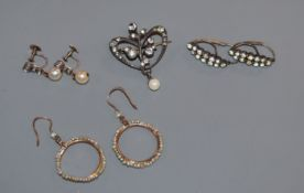 A pair of yellow metal and seed pearl loop earrings, a 19th century paste set brooch and two pairs