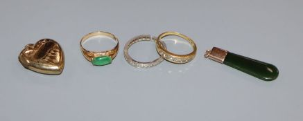 An 18k 750 and channel set diamond ring, a 585 and jade ring, a diamond eternity ring(a.f.) and