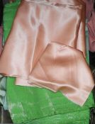 A 1930s length of lime green silk, another length of crepe de shine peach satin, etc