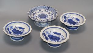 Four Chinese blue and white footed dishes largest diameter 20cm