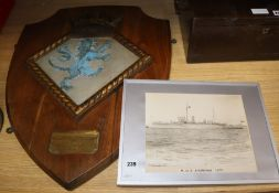 A ship's crest 'presented by The Lord Commissioner of The Admiralty to Shoreham-By-Sea to
