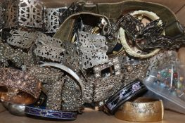A mixed group of assorted costume jewellery and other items including bangles, plated belts,