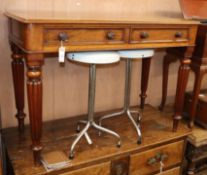A Victorian mahogany two drawer side table W.104cm