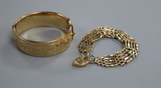 A 9ct gold gatelink bracelet with padlock clasp and a 1/5th - 9ct gold engraved bangle, bracelet
