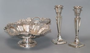 A pair of George V silver candlesticks (a.f.) and a plated cake basket height 22cm