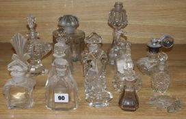 A collection of cut glass perfume bottles