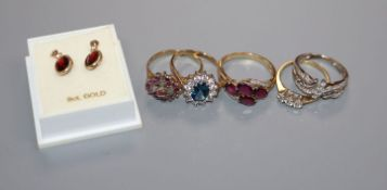 Five assorted 9ct gold gem set rings and a pair of yellow metal and garnet earrings.
