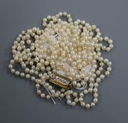 A long single strand cultured pearl necklace, with diamond set yellow metal clasp, 155cm.
