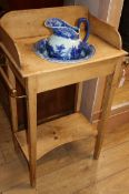 A Victorian pine washstand with later blue and white jug and basin W.62cm